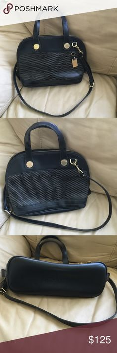 RARE Perforated Cabriolet Dooney Doctor Crossbody RARE Perforated Cabriolet Dooney Doctor Crossbody. Looks in great condition, two straps, minimal wear. Inside 3 slip pockets and the top zips closed. 14 in wide 10 in tall 4 in deep. Smoke free. Dooney & Bourke Bags Crossbody Bags