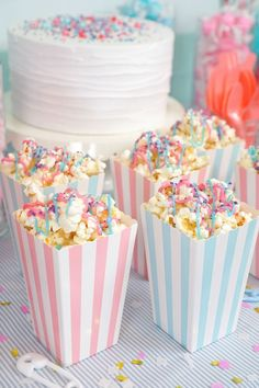 Baby shower themes Pink and blue striped popcorn boxes filled with pink and blue drizzled popcorn Gender Reveal Party Ideas by Happiness is Homemade using Hold the Balloon party supply packs so it's a simple to plan party where you can hold onto the joy Simple Gender Reveal, Gender Reveal Party Games, Gender Reveal Themes, Pregnancy Gender Reveal, Gender Reveal Party Decorations, Baby Shower Gender Reveal, Gender Party Ideas, Gender Reveal Twins, Baby Reveal Party Ideas
