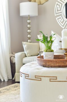 Decked and Styled Spring Home Tour - Kelley Nan- spring living room with natural elements and woven tray and green plants