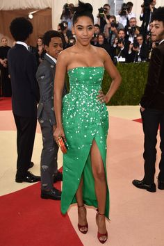 Herizen F. GuardiolaSometimes all it takes is a bright emerald green to stand out in a sea of silver, as Herizen F. Guardiola proves in a strapless, embellished Monique Lhuillier dress with a not-quite-Angelina-Jolie level slit. #refinery29 http://www.refinery29.com/2016/05/109782/best-dressed-met-gala-2016#slide-8