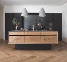 Herringbone floor and floating  kitchen island