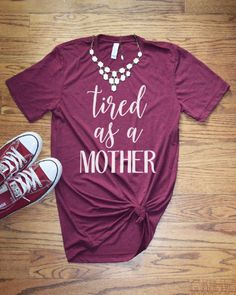 "Women's Graphic Tee - Tired as a Mother - Mom Shirt Funny T Shirt Mom Life This ""Tired as a Mother"" short sleeve mom shirt and funny graphic t shirt is sure to make any day brighter and have everyone asking you where you got this great soft shirt. Our shirts are 100% made in the USA, and we use a high-quality unisex t-shirt that is insanely soft. In fact, it will be one of the softest, best fitting, most comfortable shirts you've ever owned."