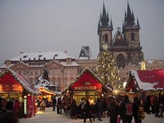 Christmas market at Old Town Square in Prague covered with snow. Stunning!