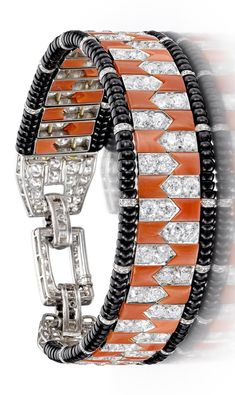 Cartier - An Art Deco coral, onyx and diamond bracelet, circa 1922.