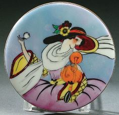 A NORITAKE ART DECO POWDER BOX CIRCA 1925 WITH HAND PAINTED OF A WOMAN IN A HAT