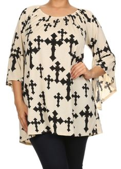 Cream colored light weight top has black crosses printed all over the top. It can be worn both on or off shoulder.