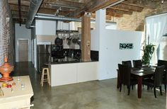 Keeping Hard Wood Flooring Looking Its Best Concrete Floors, Hardwood Floors, Flooring, Exposed Brick Walls, Polished Concrete, Wood Ceilings, Workout Rooms, Open Concept, The Unit