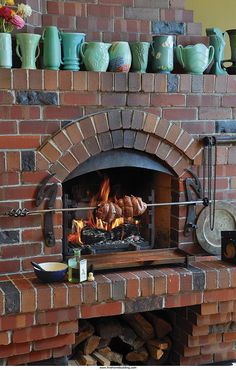Right around the corner from the big island, a fireplace with a rotisserie is th. - Decoration Fireplace Garden art ideas Home accessories Indoor Grill, Indoor Pizza Oven, Outdoor Oven, Indoor Outdoor, Fireplace Kits, Brick Fireplace, Fireplace Design, Parrilla Interior, Pizza Oven Fireplace