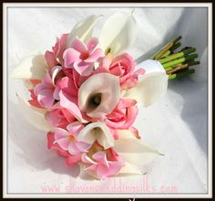 Romantic pink and white roses, calla lilies, plumeria wedding bouquet. Also pretty.