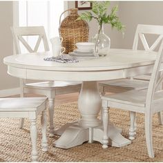 Eminence Extendable Dining Table- Eminence Extendable Dining Table This Destin Extendable Dining Table is ready to bring farmhouse vibes to your home. The dining table features a plank table top for an added rustic feel. It sits atop a turned pedestal bas Round Pedestal Dining Table, Dining Table Design, Solid Wood Dining Table, Dining Table In Kitchen, Dining Tables, Round Extendable Dining Table, White Round Kitchen Table, Farmhouse Round Dining Table, White Dining Room Table