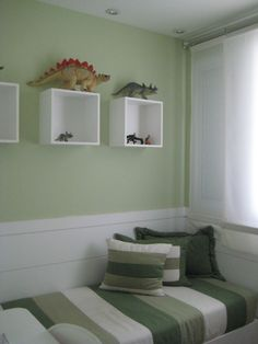 Boxes hung on wall displaying dinosaurs