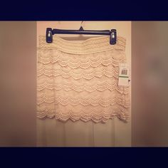 Crocheted skirt Stylish cream colored crocheted skirt. This is a junior size large. Will take reasonable offers for this skirt. Skirts