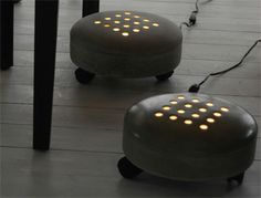 A lamp made in concrete to put feet on for warmth (design:Tove Adman)