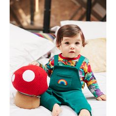 Dress your little one in cute, retro style with these super soft dungarees. In a soft navy and with adjustable straps and a popper opening on the waist for comfort, and easy dressing, these adorable Little Bird by Jools Oliver dungarees feature the classic toadstool and rainbow appliqué and embroidery with a white stipe.