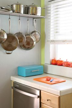 must. have. pot rack. (for our tiny galley kitchen)