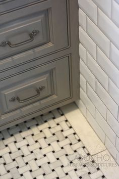 Basketweave Mosaic In Black And White Is Featured On This Guest Bath Floor Full Wall
