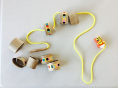Stringing activity, 40+ activities for toddlers, activities for 18-24 month old, activities for 18 month old, activities for 19 month old, activities for 20 month old, activities for 21 month old, activities for 22 month old, activities for 23 month old, activities for 24 month old, activities for two year old, activities for three year old, learning activities for toddlers
