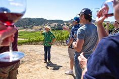 Taken at Ampelos Cellars Annual Party, Sally Ann Field caught Peter Work toasting the vines during a vineyard tour.