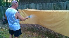 How to Make Lightweight Oilskin Tarps from Bed -Sheets - looks cool, not sure why he used wicks though.