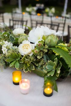 Green and white wedding centerpiece. greenery, artichoke, rose, lily, natural, cream, olive tones.