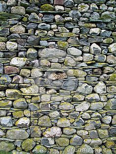 Image of cumbrian, barn - 33725949 Cumbrian Stone Wall. The end of a Cumbrian barn wall found in the Langdale valley made of the local stone.