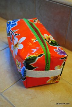Toiletry Bag Tutorial - This post will show you the detailed instructions on how to make an oilcloth toiletry bag. You will love this durable, fun bag.