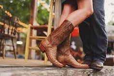 Love this picture like boots! country engagement photo