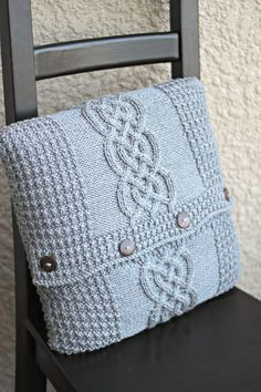 Knitting pattern, knitting tutorial for a pillow cover with a central cable motif and waffle pattern borders.  In the pattern you will find a written description and a char... #kgthreads