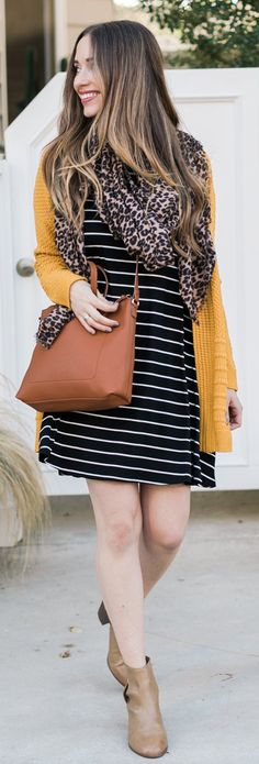/ Mustard Cardigan / Striped Dress / Camel Leather Tote Bag / Beige Leather Booties / Leopard Scarf Source by cappycross Mustard Cardigan Outfit, Mustard Scarf, Jumper Outfit, Cardigan Outfits, Dress With Cardigan, Dress Outfits, Cool Outfits, Fall Outfits 2018, Spring Outfits