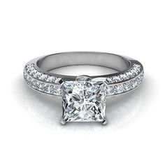 This stunning engagement ring has a squared shank with pavé diamonds on all three walls.