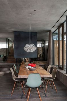 Dining room - eames chairs - dark fireplace