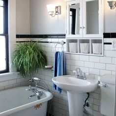 The traditional white subway tile look is always nice, but playing around with other pieces in different colors will make a tile wall stand out from the rest. Here, black accents, bullnose cap, and cove pieces make this neutral bath command attention. |