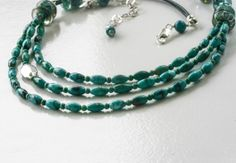 Turquoise and artisan lampwork on leather by LibertyOriginals, $72.00