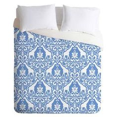"Bring cosmopolitan charm to your master suite or guest room with this eye-catching cotton duvet cover, showcasing a damask-inspired trellis motif with giraffe details and a pale blue palette. Made in the USA.  Product: Duvet coverConstruction Material: Polyester and cottonColor: Pale blueFeatures:  Designed by Jacqueline Maldonado for DENY DesignsMade in the USAHidden zipper closure Dimensions: Twin: 88"" x 68""Queen: 88"" x 88""King: 104"" x 88""Note: Duver does not include insertCleaning and ..."