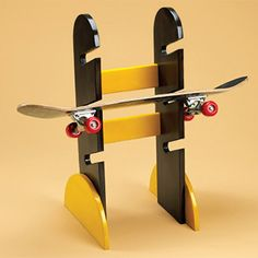 Make this skateboard rack for your kids, or it's a great gift idea. We sprayed outs with Rust-Oleum 2X spray paint.