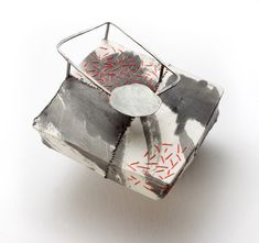 "Myung Urso - ""Relationship"" (2008). Brooch. Silk, oriental ink, thread, sterling silver, lacquer."