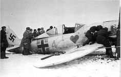 "Soviet soldiers inspect the German aircraft ""Focke-Wulf"" Fw 190A4 (included with JG 54), shot down near Leningrad. 1 February 1943"
