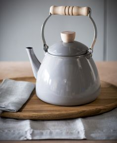 Although Tara has all the mod cons when it comes to making drinks downstairs in the cafe, this feels right for her hygge-inspired flat Grey Enamel Stove Kettle - The Forest & Co. Kitchenware, Tableware, Serveware, Best Tea, White Enamel, Wooden Handles, Traditional Design, Kitchen Accessories, Stove