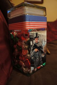"""For those in your life who's loved ones are deployed/deploying...my sister did something much like what this girl did: My brother-in-law deployed and they bought enough Hershey's kisses to give each of their two children one each night. They call them """"Kisses from Daddy"""", so that they still get a """"kiss goodnight"""" every night he is gone. they are in a cute little container (not like this one, but I don't have a picture of my sisters, and this is a similar idea) and the kids know that is where Daddy's kisses come from. They also know that, when the candy kisses are gone, Daddy will be home to shower them with REAL kisses! It's so cute! On THIS particular blog, the blogger made them and gave them as gifts to her family for her cousin's deployment, and when their kisses run out, he will be home. =)"""