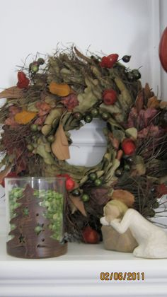 Mantle Christmas decorations with wreath and Willow People
