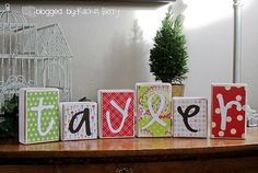 painted sanded wood blocks covered in bkgrd paper and cricut letters.  all covered in modpodge.  excellent