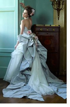 Ian Stuart: this designer's dresses are all about making a statement, and what better time to do so than on your big day? Bold colours, extravagant fittings and lusciously long tails -  take your pick!