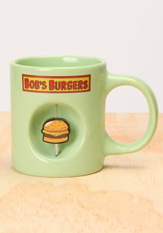 Exclusively available from Newbury Comics! 11 oz ceramic mug. Join a Belcher family food fight and send a burger spinning. Bob's Burgers Merchandise, Coffee Cups, Tea Cups, Burger Party, Tina Belcher, Little Presents, Bob S, Bobs Burgers, Cool Mugs