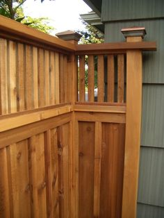 Cedar fence with copper caps