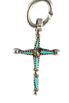 Vintage 1970s charm for a bracelet.  This is a sterling silver, hand made charm that is in the shape of the Holy Cross.  It is set with