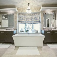 Our Mia Chandelier looks to be the perfect jewel to finish off the bathroom designed by the talented @henrykatedesign.  This bathroom is exactly where we would want to relax during the long weekend! #bathroomdesign #relaxandchill #laborday #classicdesign #interiors #design #mypotterybarn