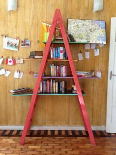 Recycled ladder turns into beautifully colorful bookcase!