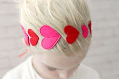 Valentines Headband with Red and Pink Hearts. Ties with a ribbon at the nape of the neck.  So cute!