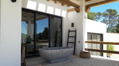 Ibiza villa by COCOON with Piet Boon® by COCOON design taps bycocooon.com | terrace with stone bathtub | bathroom design | villa design | interior design | exterior design | dreamhomes | Dutch Designer Brand COCOON