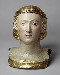Reliquary Bust of Saint Juliana, ca. 1376. Italian. Copper, gilding, gesso, and tempera paint. The band along the lower edge of the bust is inscribed, on the front: [C]APUD SANTE IULIANE [head of St. Juliana], & on the back: ROMA. A. D[OMINO]. GUILLE[LMO] [Rome, year of Our Lord, William]. In 1376, the skull of Saint Juliana, the gift of the brothers of San Domenico to the Perugian convent dedicated to the saint, was carried in procession & received by Abbess Gabriella.